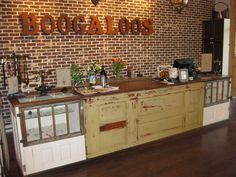 http://www.woodtalkonline.com/blog/74/entry-1398-sales-counter-final-pics/#  Sales counter built from salvaged doors, windows, and flooring.
