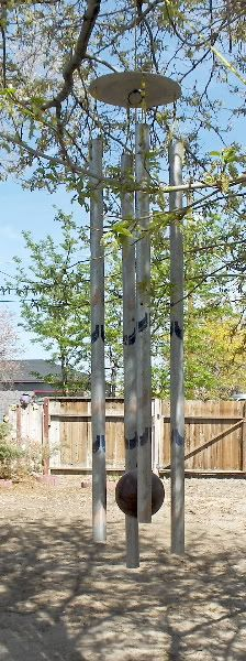"Of bowling balls and wind chimes - Garden Junk Forum - GardenWeb My neighbor had an old child's swing set and I salvaged the tubes. The longest one is 82"". Actually they are not that heavy and do move in the wind. The amazing thing is the bowling ball also swings - no kidding. It is a muted sound and really does not make a lot of noise. My DW asked me if I was going to paint them - NO!"