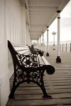 The benches at Brighton pier, Matthew and Jake sat, waiting for their mother.