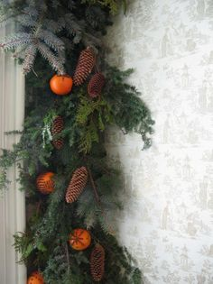 standing garland with oranges and pines cones