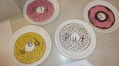 """pick up the donut and put it on a different """"vowel"""" plate to make a new word"""