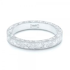 #102850 This elegant women's wedding ring features a lovely hand-engraved pattern on the top and fronts of the ring, all sections of which are framed with milgrain beading. It...
