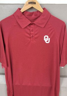 Be the envy of the office and show your Oklahoma Sooners pride in this Mens Crimson Wellington Short Sleeve Polo! Rally House has a great selection of new and exclusive Oklahoma Sooners t-shirts, hats, gifts and apparel, in-store and online. A Team, Team Logo, Team Mascots, Professional Wardrobe, Oklahoma Sooners, Short Sleeve Polo Shirts, Short Sleeves, Pride, Mens Tops