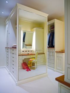 Closet Organization: Part Two - Design Chic - plenty of storage in this closet - love the mirrored walls