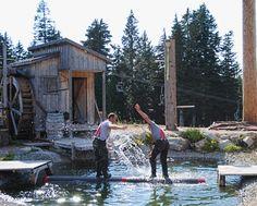 Lumberjacks logrolling in a humorous show at Grouse Mountain Resorts