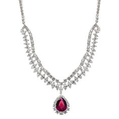 Pink Tear Drop Necklace $ 565.00  This beautiful statement tear drop crystal pendant necklace will make every occasion a special occasion.