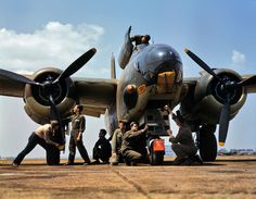 1940's Kodachrome picture of World War II plane and crew.
