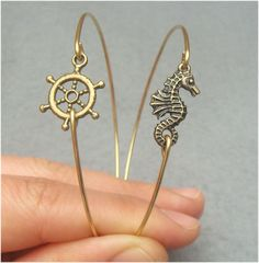 cute charms with hole at one end and loop/space to loop wire at the other, and some thick, strong wire and a bender and cutters. Simple cute cheap.