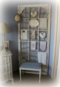 Salvaged Screen Door Facelift - a great way to add height to a room.  She attached a lace tablecloth to it  uses it to display her treasures so there are no holes in the wall!