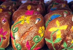 Pan de muertos, an anise-flavored egg bread that is usually shaped in an oval (said to be the shape of the soul) and decorated with bright colored pieces of dough and sugar. The bread can also made into round, skull and bone shapes.