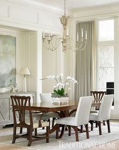 Replace your traditional matching chairs with upholstered chairs to update your traditional dining room. More tips for Dressing Your Dining Room on SwatchPop!...