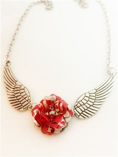 """Coca-Cola Wing Necklace This beautiful necklace has two antique silver metal wings with a recycled coca cola aluminum can flower in the middle. The necklace is a generous length of 25"""" and can be shor"""