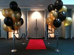For this event we set-up our red carpet with ropes and designed the balloon trees to accent the doorway. #Atlanta #rental #red #carpet #entrance #VIP #stanchion