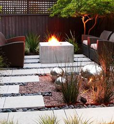 A fire pit fights the cool of foggy evenings in the seating area of this urban San Francisco garden designed by Arterra Landscape Architects. Meanwhile, the sculptural steel balls elegantly reflect the movement of the flames.