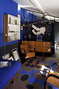 Florence Lopez's Parisian apartment: Alvar Aalto armchairs, model 31/42, by Artek, Finland 1932. Wall light by Pierre Guariche, 1955. ...