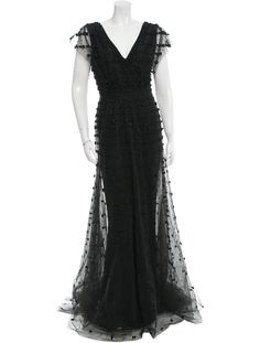 Black Elie Saab sleeveless gown with tonal beaded embellishments featuring mesh overlay throughout, V-neck and concealed zip closure at side.