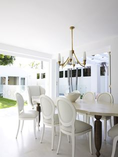 Bright white dining room | Designed by Greg Natale