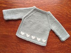 Love this pattern it's the second time I've knitted this little cardi, we have a new grand baby on the way in a few weeks time, so exiting! Decided to do hearts this time instead of stripes. Baby Cardigan Knitting Pattern, Baby Patterns, Sweater Knitting Patterns, Baby Girl Cardigans, Baby Sweaters, Tricot Baby, Knitting For Kids, Knit Baby Sweaters, Wool Sweaters