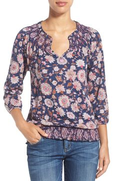 Free shipping and returns on Lucky Brand Floral Print Blouson Top at Nordstrom.com. A slubbed cotton-blend top flaunts a pretty floral print popped against a deep-blue background. The billowy cut is gathered to stretchy smocking at the neckline and hem for a comfortably loose yet controlled fit.