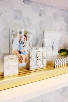 DIY picture ledge with plexiglass framed photos
