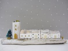 Handmade driftwood cottage sculpture with miniature Christmas tree