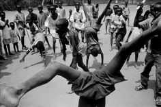 Eli Reed - Boys playing in the camp, Kakuma Refugee Camp, Kenya. August 2001