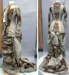 Grey and brown satin dress with brocade, ca. 1870-90. Princess lines, long sleeves, bustle, and trim. Closes down the front with crocheted buttons. North Carolina Museum of History