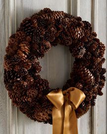 Pinecone wreath. I made one of these in high school... hard work!! But so pretty. :)