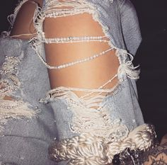Ripped jeans. Denim. Pearls.