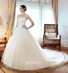 This vintage floor length winter wedding dress is stunning with it's beaded strapless bodice decorated lace applique detail