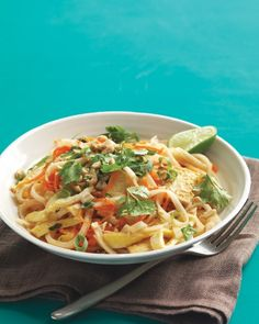 Vegetable and Tofu Pad Thai | Make a healthier version of the tasty Thai classic in less time than it takes to have it delivered. If you have fish sauce and aren't a strict vegetarian, substitute it for the soy sauce. It will give the dish deeper flavor.
