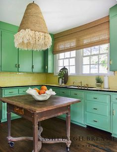 ASHLEY GILBREATH INTERIOR DESIGN: An antique butcher block, brass fixtures, and a neutral woven shade with raffia fringe add visual appeal to this cottage kitchen. Original cabinet color and countertops were updated with brass pulls. Antique Kitchen Island, Vintage Kitchen, Old Cottage, Cottage Style, Ashley Gilbreath, Yellow Tile, 1920s House, Built In Shelves, Modern Kitchen Design