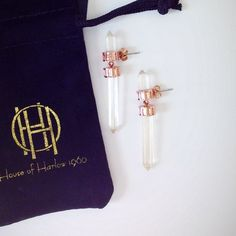 """House of Harlow 1960 Glacier Drop Earrings FINAL PRICE! Rose gold toned accents, with the iconic clouded glacier prism """"gems"""". They come with the House of Harlow earring holder (the cardboard/plastic thing) and the authentic velvet monogrammed purse. These are authentic. One of the prisms is chipped, but hardly noticeable. Price reflects this defect. No trades. No PayPal. No lowball offers. These are sold out. House of Harlow 1960 Jewelry Earrings"""