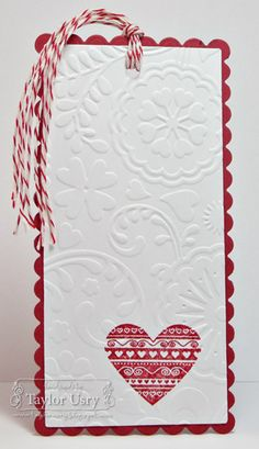 Embossed card stock w/decorative base + heart cut-out.