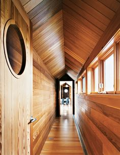 Richly hued red cedar lines the corridor of a house on the Magdalen Islands in Quebec. The view from the master bedroom down the long cedar corridor into the living room is one of the home's real pleasures. Cedar Paneling, Diy 2019, Wood Ceilings, Wood Walls, Western Red Cedar, Coastal Homes, Interior And Exterior, Interior Design, Van Interior
