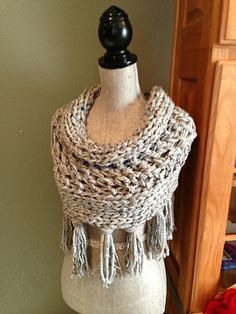 Ravelry: Gray 3-Strand Cowl with Fringe pattern by Louis Chicquette.