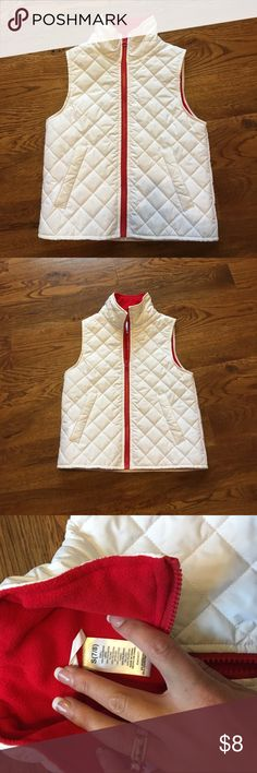 Girls white best with red zipper and fleece lining Very cute - worn 1 time. Red zipper white quilted performance fabric. Looks waterproof. My daughter made me cut the itchy tag out and o cannot remember what brand it was. It is good quality. Size 7/8. No stains or damage. Jackets & Coats Vests