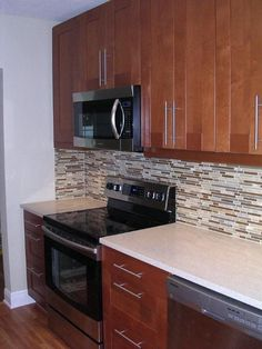 Best Adel Medium Brown Cabinets With A Eye Catching Backsplash 400 x 300