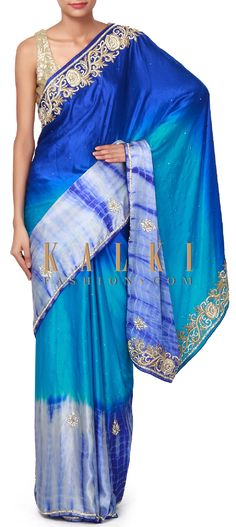 Buy Online from the link below. We ship worldwide (Free Shipping over US$100). Product SKU - 310797. Product Price - $339.00. Product link - http://www.kalkifashion.com/shaded-saree-in-blue-with-embroidered-border-only-on-kalki.html