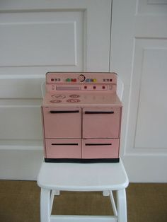 pink wolverine toy stove.  I had this in white.  My husband found one like mine in an antique shop and bought it for me!!  Oh the memories!