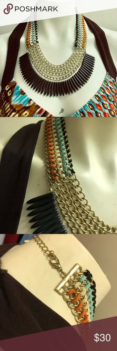 Bohemian, Goth, Tribal, Bib Choker Necklace Suede Leather Woven Through the Gold Tone Chains. Suede is Orange, Blue, White and Black. Black Spikes are most likely Jet. They are black all the way through. Vintage Jewelry Necklaces