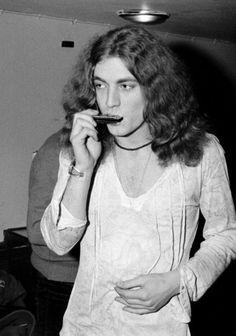Robert playing the harmonica