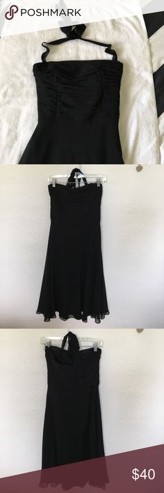 Black cocktail dress Black silk cocktail dress. Size 6. Worn once and dry cleaned. Flowy and fun for any occasion Maggy London Dresses Midi
