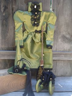 Gorgeous Halloween Victorian style Witch dress all hand made...dress, broom, hat, & boots...bells, lace buttons feathers...green sheen fabric trimmed in black lace with a touch of Sweet Annie on broom. By Precious*Attic*Prim's--JoyLynn