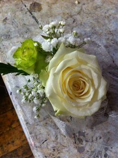Bridesmaids wrist corsages of roses and gypsophila and pearls.