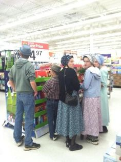 Out of place Amish - they're not amish, they have patterned dresses and bonnets. Maybe Mennonites
