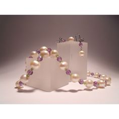 Parure: Necklace and earrings with 1st quality freshwater pearls, amethyst, peridot and silver closure. Shop now: http://www.giuliasorvillodiserino.com/en/haute-couture/97-collana-con-perle-ametista-e-peridoto.html