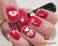 This quirky look was created with nail stickers and rhinestones. | 26 Ridiculously Sweet Valentine's Day Nail Art Designs