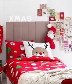 Red Christmas bedding with Santa Claus, reindeer, and tree from H & M Finland