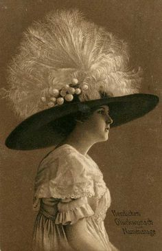 Large plumed hats were fashionable for women in the 17th century. When postcards began to be manufactured, hats were considered an important part of dress for both men and women serving as a symbol of social status.  As hair lengths grew shorter after the First World War hats grew smaller and more fitting. By the 1930's milliners were losing business to uniform factory made hats. When hair styling became paramount in the 1960's hats disappeared as a fashion statement.